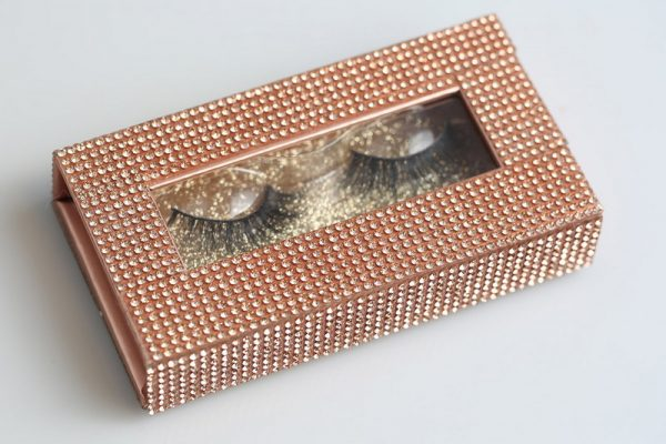 Rose gold glitter on paper box